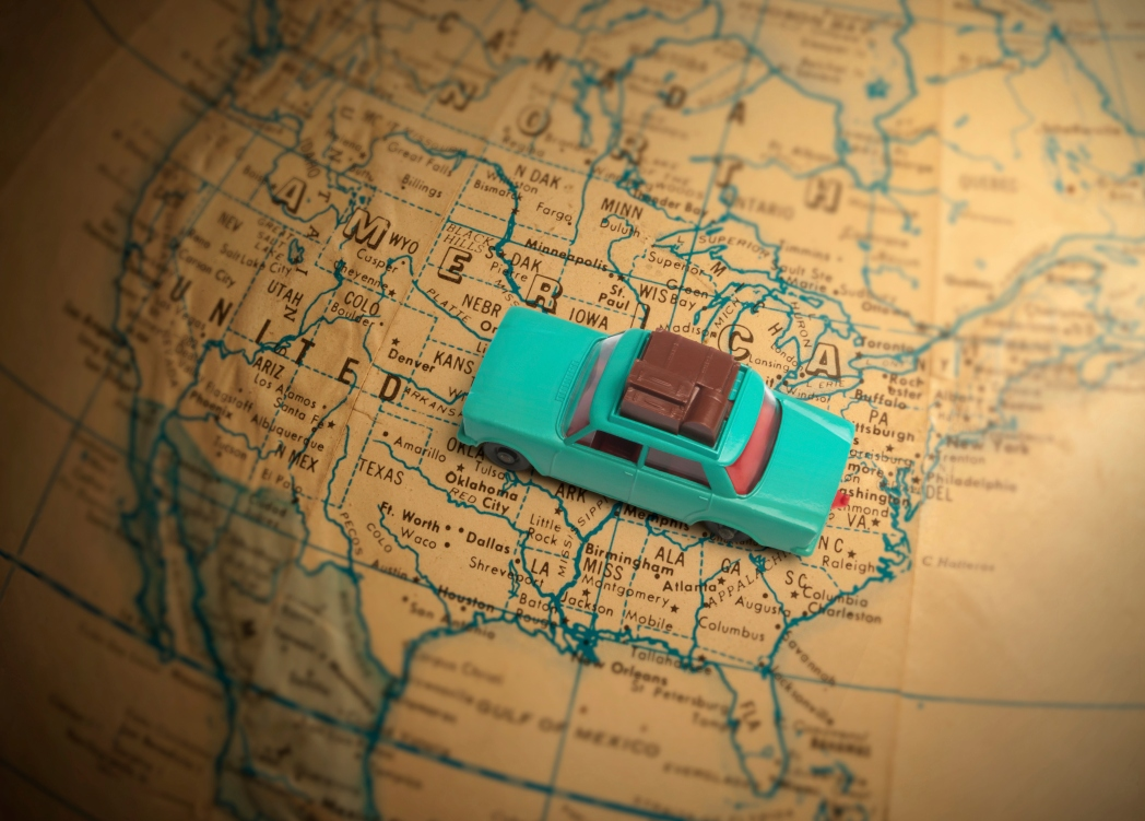 Image of a toy car on a world globe. Tips to Help You Get the Best Car Rental Deals / Skyscanner Canada