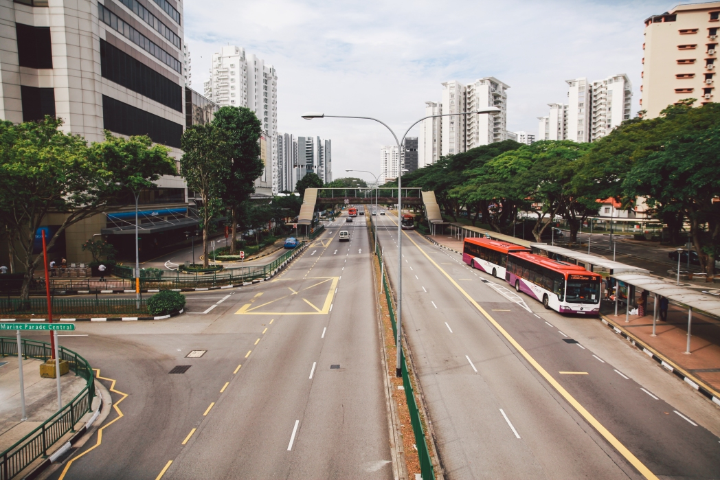 View of a road with skyscrapers. Transportation in Singapore | Skyscanner Canada